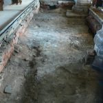 Removal of rotten timbers to Nave floor looking East